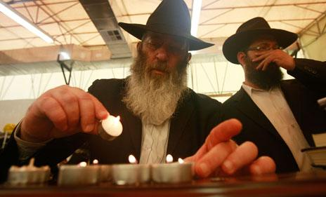 Lubavitch Hassidic Jews in New York light candles on the anniversary of the death of their leader