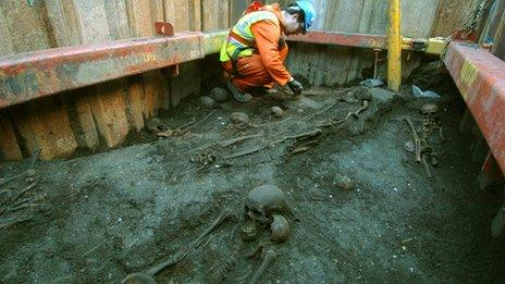 Archaeologist and skeletons