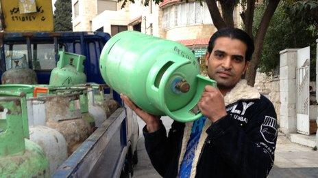 Man carries canister of gas