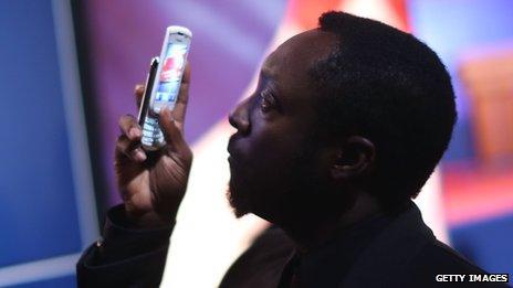 Will.i.am using phone