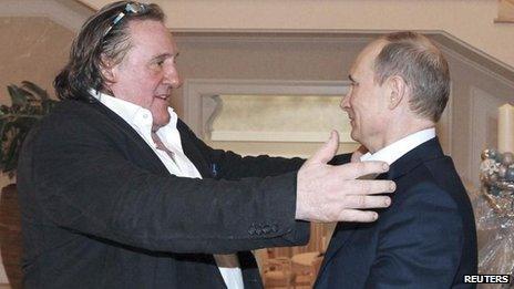 Russian President Vladimir Putin (R) greets French actor Gerard Depardieu in Sochi, 5 January