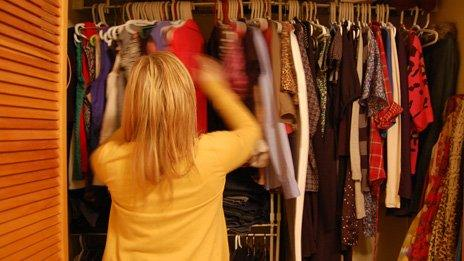 Jillian Rae Greenwood in Ottawa, Canada looking through her wardrobe deciding what to wear