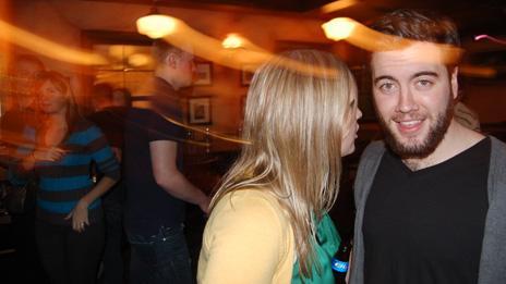 Jillian Rae Greenwood talking to a man at a nightclub in Ottawa, Canada