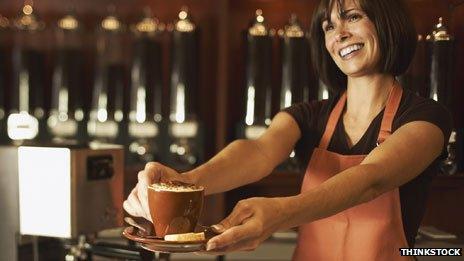 Barrista handing customer a coffee