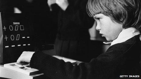 Boy using a school computer in 1981
