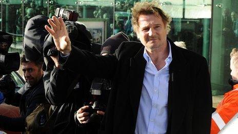 Liam Neeson waving