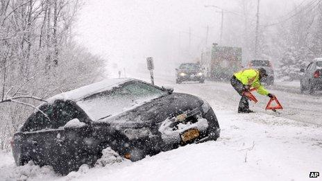 A car is stuck in a ditch in the snow in Buffalo, New York 8 February 2013