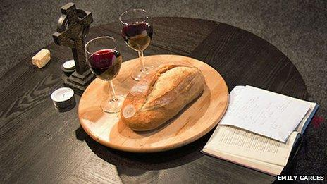 Eucharist meal against a background of black