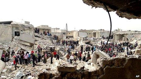 People search rubble for bodies in an area of Aleppo reportedly destroyed by a government missile strike
