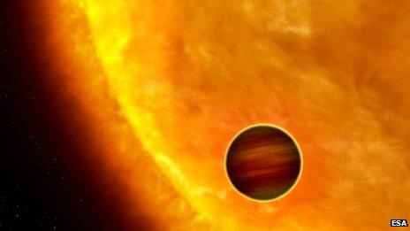 An artist's impression of an exoplanet orbiting close to a star