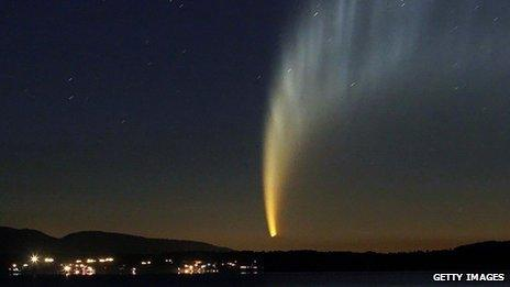 The McNaught comet appearing over Chile