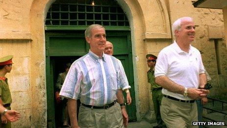 Pete Peterson and fellow Vietnam veteran John McCain leaving the Hanoi central prison