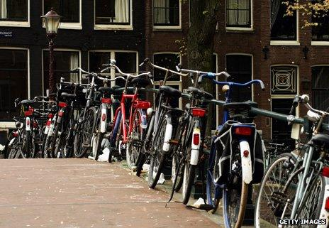 Bikes parked on a canal bridge in Amsterdam