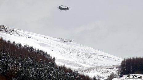 Chinook over snowy valley