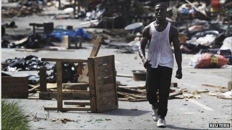 A man walks through a ransacked market in Abidjan April 14, 2011