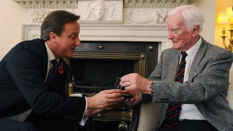 Leslie Valentine receiving the Defence Medal from Prime Minister David Cameron at 10 Downing Street