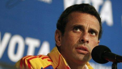 """Venezuela""""s opposition leader and presidential candidate Henrique Capriles attends a news conference in Caracas"""