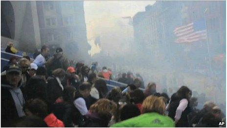 Smoke from the second Boston blast as spectators attempt to escape