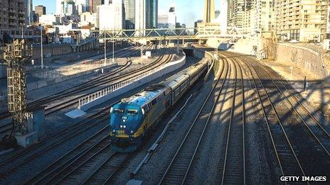 A VIA Rail train leaves Union Station in Toronto, Ontario, Canada. 22 April 2013