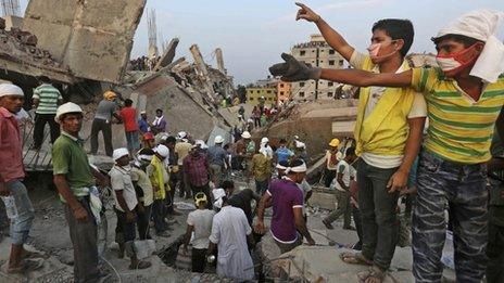 Bangladeshi rescue workers gesture for help