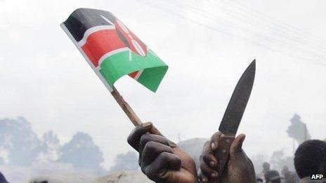 A Kenyan flag and knife held aloft after elections in December 2007