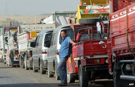Egyptian motorists line up to buy fuel at a gas station in Cairo on March 11, 2013