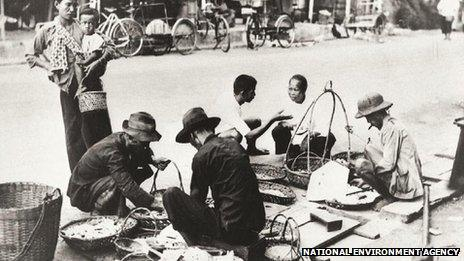 File photo: food hawkers on a street in Singapore