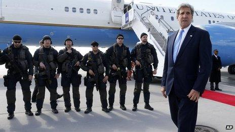 John Kerry prepares to board a plane in Stockholm