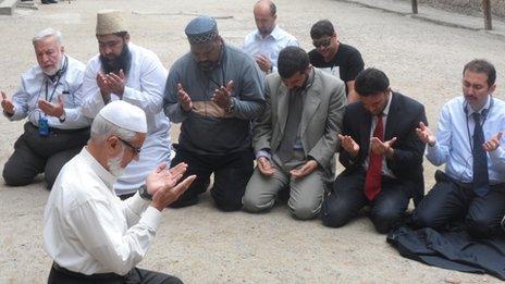 Muslims pray during a trip to Auschwitz