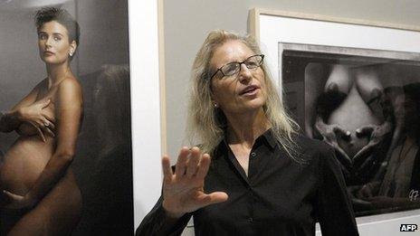 Annie Lebovitz next to her picture of actress Demi Moore