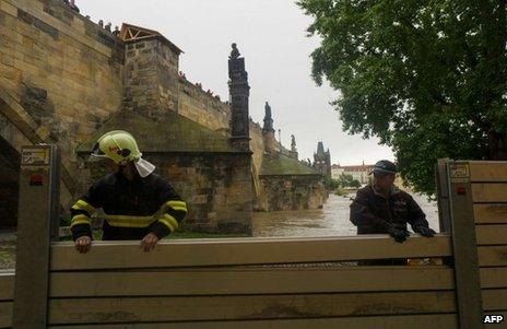 Anti-flood barriers are erected on the left bank of the River Vltava in Prague, 2 June