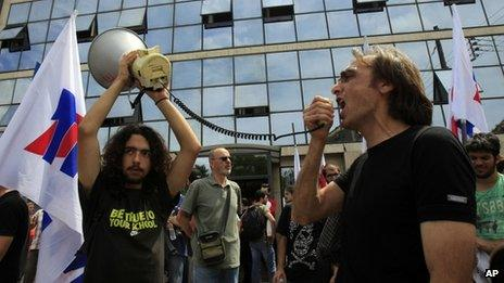 Workers protest outside ERT's headquarters in Athens (12 June 2013)