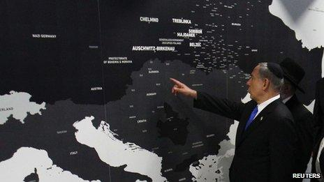 Israeli Prime Minister Benjamin Netanyahu points at a map showing where Jews were killed during the Holocaust at the opening of the Permanent Exhibition SHOAH at the former Nazi death camp Auschwitz-Birkenau State Museum, Block 27,