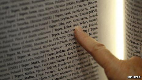Rachel Barkai from Yad Vashem looks for a name of her relative in The Book of Names which contains 4,2 million names of Jews killed during Holocaust at a Permanent Exhibition SHOAH at the Auschwitz-Birkenau State Museum, Block 27