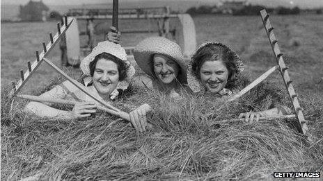Farm girls in a haystack