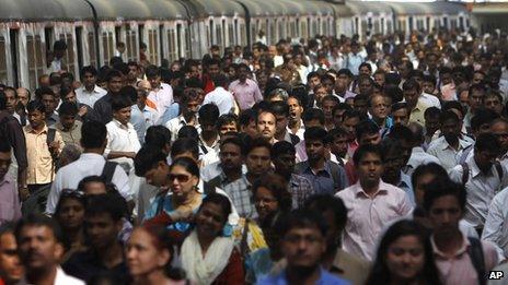 Commuters disembark from trains in Mumbai (file photo)