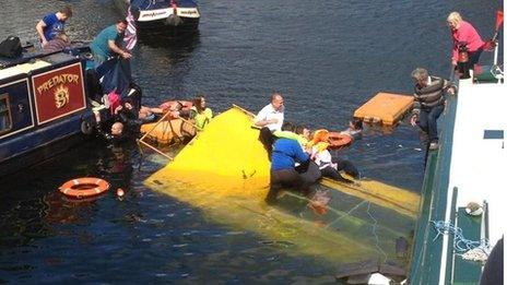 People being rescued from the sinking duck marine