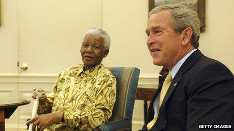 US President George W Bush (R) meets Nelson Mandela in the Oval Office of the White House in Washington DC on 17 May 2005