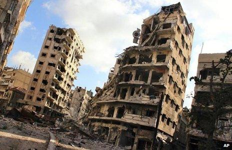 Photograph published by activists purportedly showing buildings damaged by conflict in Homs (3 July 2013)