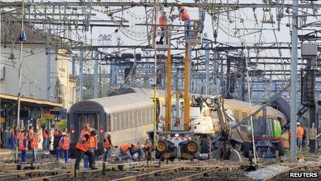 On 13 July engineers inspect the wreckage of a train that crashed a Bretigny-sure-Orge station in France
