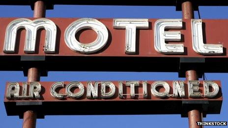 """A motel sign saying """"Air conditioned"""" below"""