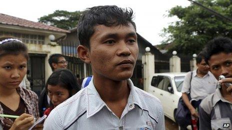 Chit Thura Ko Ko, a Myanmar political prisoner who was released from Insein Prison after receiving amnesty from Myanmar's President Thein Sein, talks to journalists outside the entrance of the prison Tuesday, July 23, 2013, in Yangon, Myanmar.