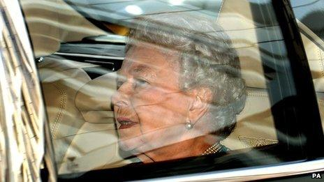Queen in Bentley car leaving Kensington Palace
