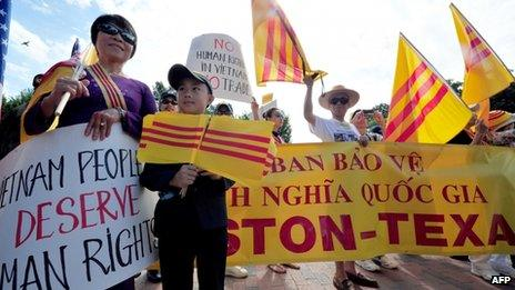 Several hundred demonstrators from the Vietnamese-American community rally outside the White House on 25 July 2013 in Washington, DC