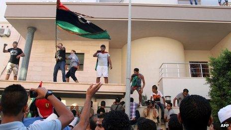 Libyan protesters attack the offices of Muslim Brotherhood-backed Party of Justice and Construction in the Libyan capital Tripoli on 27 July, 2013