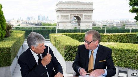 Maurice Levy and John Wren signing merger agreement