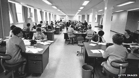 Mainly women sitting at desk in an open-plan office, 1966