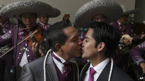 A same-sex couple kisses after getting married in Mexico City on 14 July 2013