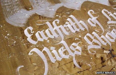 """Close-up of a detail on the Castle Keep banner, reading """"Eadfrith of Lindisfarne - Niels Shoe Meulman"""""""