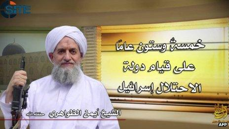 """Image of Ayman al-Zawahiri released by al-Qaeda on 6 June 2013. Arabic says: """"Sixty-five years since the establishment of the state of occupation Israel"""""""